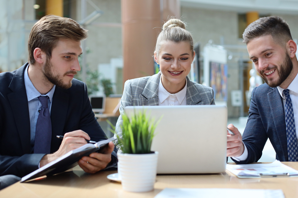 Executives looking at laptop and thrilled with Pay Per Result SEO report