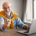 happy older man surfing the Internet