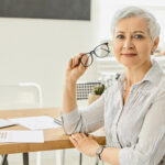thoughtful businesswoman at desk considering white label fulfillment