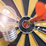 dart hitting bullseye with words key performance indicators