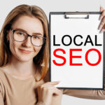 """woman holding sign saying """"local SEO"""""""
