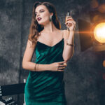 celebrity in green dress smoking